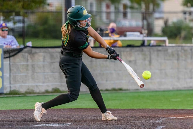Rock Bridge's Sophie Schupp (20) connects on a pitch for a base hit during a game against Hickman on Sept. 24 at Hickman High School.