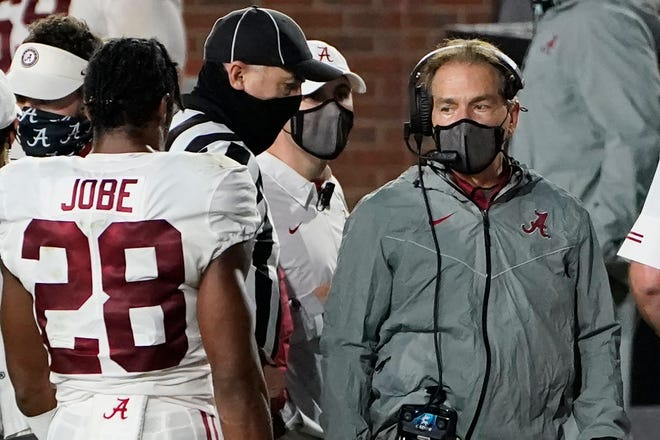Alabama coach Nick Saban, right, speaks with defensive back Josh Jobe against Ole Miss on Saturday.