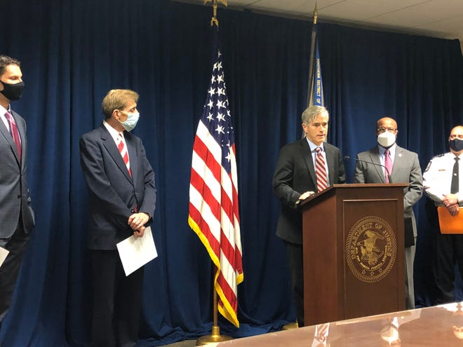 David DeVillers, center, U.S. Attorney for the Southern District of Ohio, announced on Wednesday an initiative to combat rising gun violence in Columbus. He was flanked by partners in the initiative, Columbus police Chief Thomas Quinlan, Franklin County Prosecutor Ron O'Brien, Columbus City Attorney Zach Klein, and Roland Herndon, special agent in charge of the federal Bureau of Alcohol Tobacco Firearms and Explosives field office in Columbus.