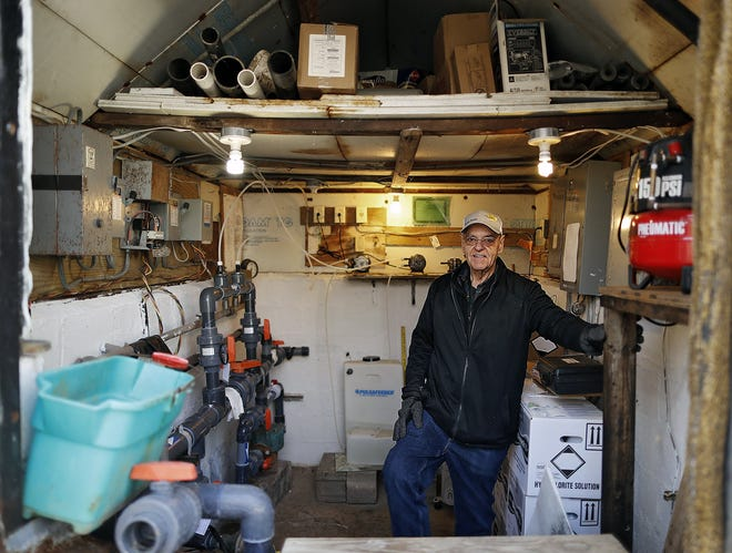 In this January file photo, Bill Ash poses for a photo in the Mount Air community well system house.