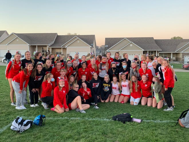 DCG girls cross country after capturing the 2020 Little Hawkeye Conference crown.