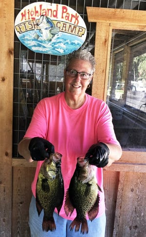 Patsy Graves, who lives in DeLand, caught these two speckled perch on Lake Woodruff fishing from Highland Park Fish Camp. Crappie USA will hold a speck tournament on Dec. 5.
