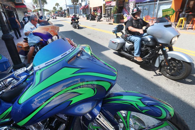 """Riders roll down Main Street in Daytona Beach on Wednesday, on the eve of this year's Biketoberfest. There will be no outdoor vendors or stages at the event this year in response to coronavirus concerns, but merchants are optimistic that bikers will still arrive in big numbers. """"It's going to be a very good event, a lot of people in town,"""" said Tom Caffrey, co-owner of the Pallet Pub on Main Street."""