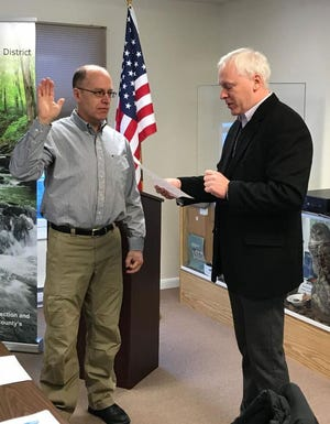 Mike Spencer, at left, received the oath of office to serve on the board of the  Pike County Conservation District, from Pike County Commissioner Ronald Schamlzle. Spencer is also on the Wallenpaupack Area School Board.