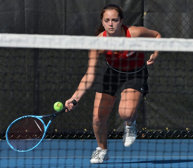 Fairview High School sophomore Lydia Soltis returns a shot while competing at No. 2 singles against McDowell during the District 10 Class 3A girls tennis team tournament.