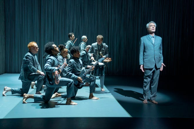 "This image released by HBO shows David Byrne, right, in a scene from ""David Byrne's American Utopia."""