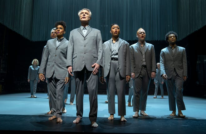 "This image released by HBO shows David Byrne, foreground, in a scene from ""David Byrne's American Utopia."""