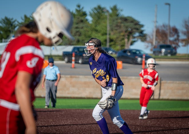 Blue Springs senior pitcher Abby Kinzler, center, celebrates after closing out a 13-5 win over Fort Osage in the first round of the Class 5 District 7 tournament Tuesday at Blue Springs.