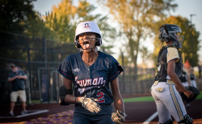 Truman's Kennedy Rucker (2) screams as she crosses home plate on an inside-the-park home run in Tuesday's Class 5 District 7 first-round game against Lee's Summit. The joy was short-lived though as the Tigers rallied for a 2-1 win.