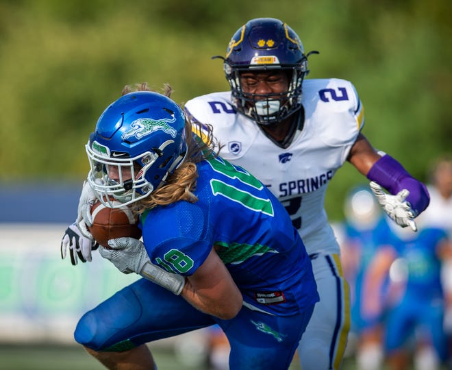 Blue Springs South's Luke Fellers (18) carries the ball in last year's game against Blue Springs. Fellers and the Jaguars will try to snap Blue Springs' six-game winning streak in the Cat Clash series when they host the Wildcats Friday night.