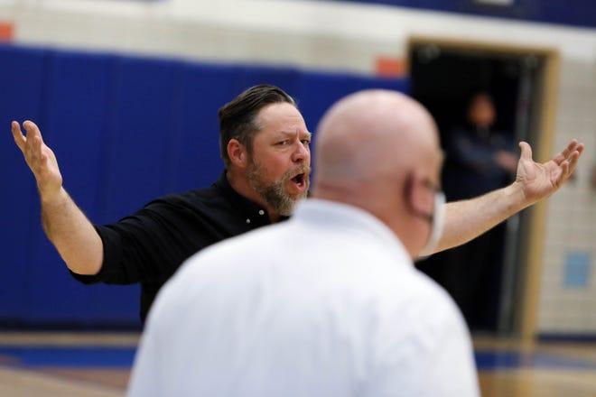 West Burlington High School's head coach Tom Ferguson questions a call during their game against Notre Dame High School,  Tuesday Oct. 13, 2020 at Notre Dame's Father Minett Gymnasium.