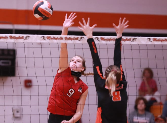 Winfield-Mt. Union senior Jenna Buffington gets a kill for the Wolves in the SEISC North Division win over Mediapolis.
