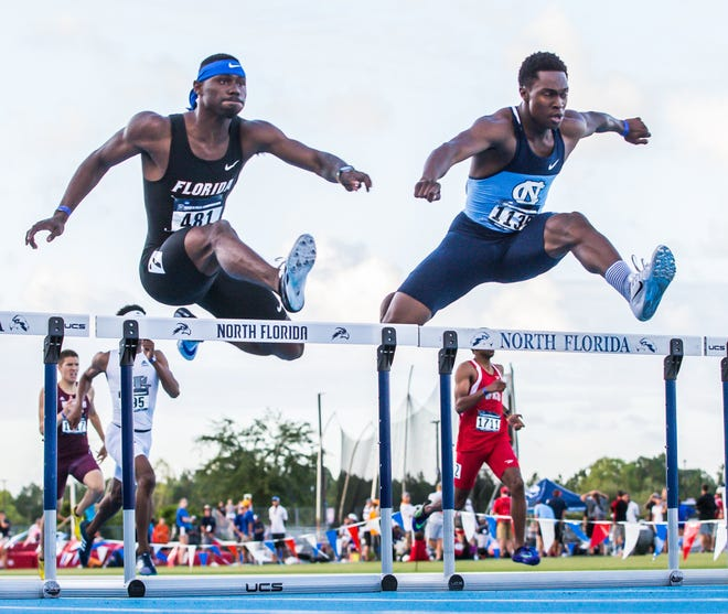 Florida's Eric Futch, left, and North Carolina's Kenny Selmon race in the 400-meter hurdles at Hodges Stadium in 2016. The NCAA East Preliminary championships are returning to UNF in 2023 and 2025.