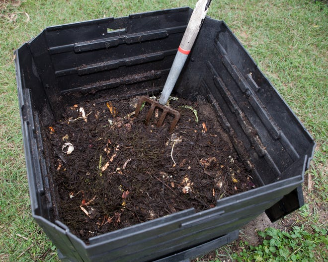 A compost bin is a good way to turn yard waste into compost, but a simple pile will also work.