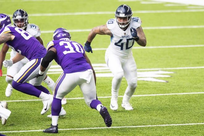 Tennessee Titans linebacker Kamalei Correa (40) competes against Minnesota Vikings fullback C.J. Ham (30) in the third quarter during an NFL football game, Sunday, Sept. 27, 2020, in Minneapolis.David Berding/Associated Press
