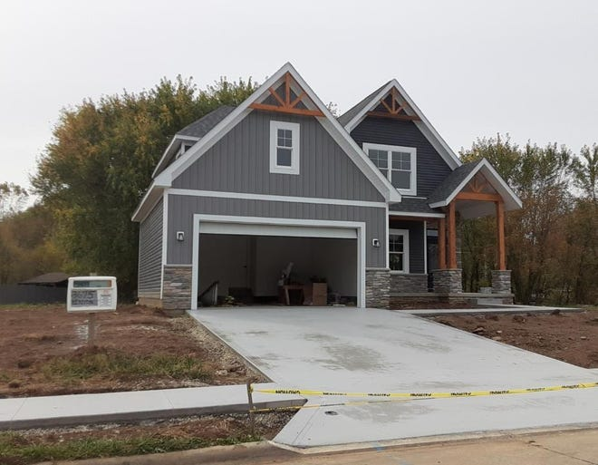 A model home is for sale at the current Kenyon Creek Estates in northwest Massillon. Developers are working on the next two phases, which include 94 new housing lots among 29 acres.