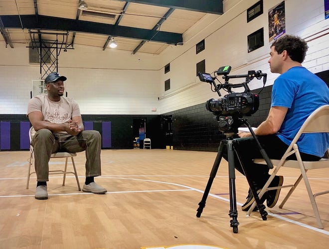 "Marcus Mizelle, director of ""Something in the Water: A Kinston Basketball Story,"" films Donald Ingram, father of NBA star Brandon Ingram, at Martin C. Freeman Center in Kinston. [Contributed photo]"