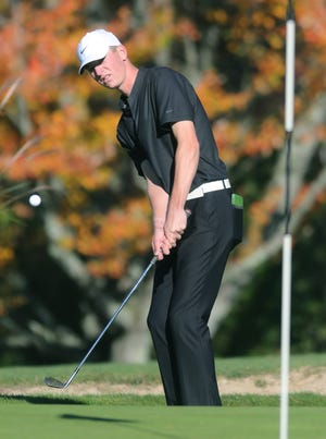 Stow-Munroe Falls' Brandon Beck chips onto the No. 1 green during the Division I district golf tournament Oct. 12 at Pine Hills Golf Course in Hinkley.