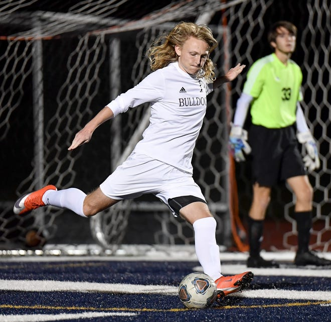 Stow-Munroe Falls defender Nick Kuhlke boots the ball ahead during a match against Hudson earlier this season. Kulhke had an assist in Stow's 2-1 home win over Cuyaohaga Falls Oct. 13