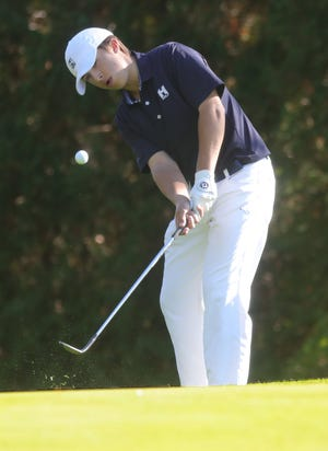 "Hudson's Ryan ""Coop"" Pamer chips onto the No. 9 green during the Division I district golf tournament Oct. 12 at Pine Hills Golf Course in Hinkley."