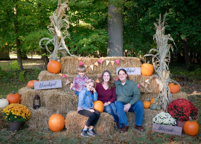 Pictured in the Fall Photo-Op is the pastor of First Christian Church, the Rev. Jonathan Rumburg, along with his wife Julie, their daughter Violet, and son A.J.