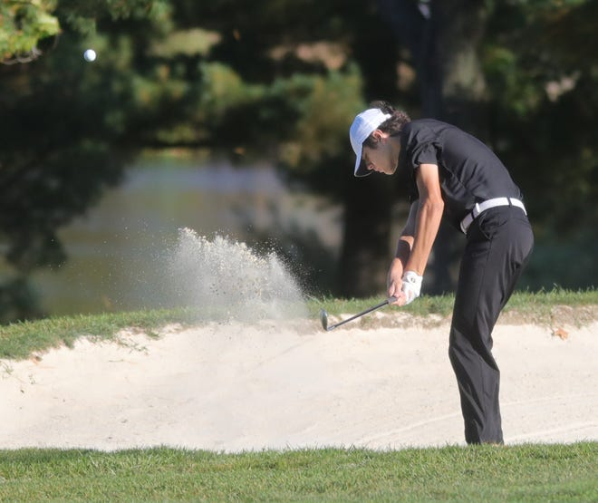 Stow-Munroe Falls' Ben Skripac hits from a fairway bunker during the Division I district golf tournament Oct. 12 in Hinkley.
