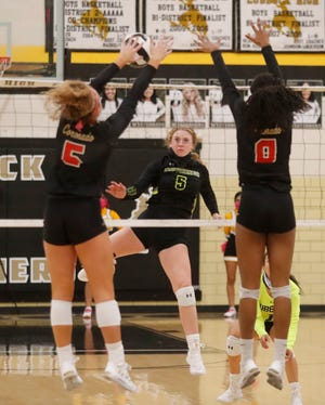 Coronado High's Caroline Willcoxon (5) and Danielle Lilly (8) block a shot by Lubbock High's Samantha Manning (5) of a District 4-5A match Tuesday at Lubbock High School.