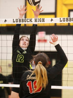 Lubbock High's Daniela Burk (12) tries to block a shot by Coronado High's Keana Pope (10) in the first set of a District 4-5A opener for both squads Tuesday at Lubbock High School.