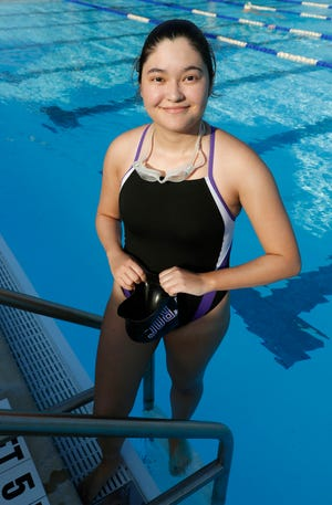Tenoroc's Emily Roman is the only member of the Titans' swim team. She learned how to swim when practice started at the beginning of the year, but the lack of experience or teammates has not stopped her.
