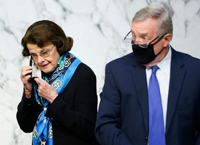 Sen. Dianne Feinstein, D-Calif., and Sen. Dick Durbin, D-Ill., arrive for the third day of confirmation hearings for Supreme Court nominee Amy Coney Barrett before the Senate Judiciary Committee on Capitol Hill in Washington, Wednesday, Oct. 14, 2020.