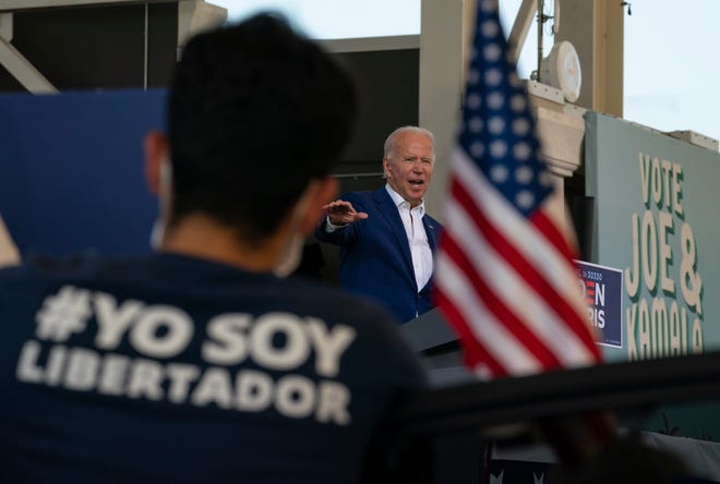 Democratic presidential candidate former Vice President Joe Biden speaks at Miramar Regional Park in Miramar on Tuesday as supporters watch from their cars.
