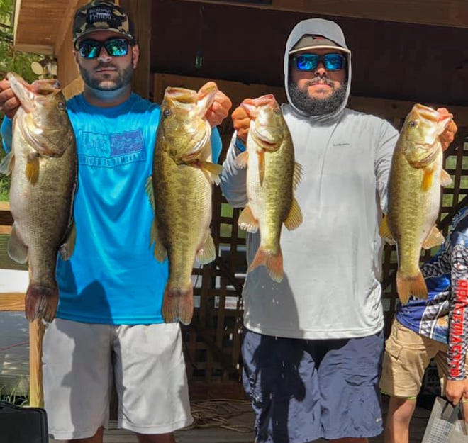 Jackson Williams, left, and Garret Rocamora had 26.37 pounds to win the Lakeland Jr. Hawg Hunters third annual Big Bass Blast tournament Oct. 10 on the Kissimmee Chain.