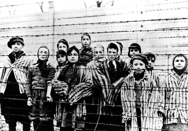 A photo taken just after the liberation of the Auschwitz concentration camp, in Poland, shows a group of young prisoners in their camp uniforms in January 1945.