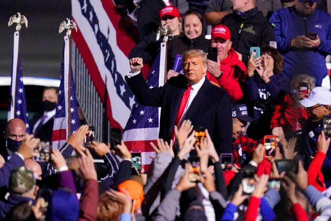Supporters cheer as President Donald Trump departs a campaign rally at John P. Murtha Johnstown-Cambria County Airport in Johnstown, Pa., Tuesday, Oct. 13, 2020.