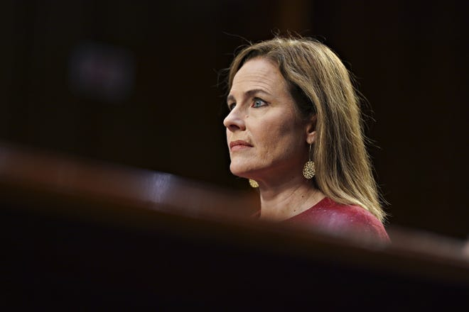 Supreme Court nominee Amy Coney Barrett listens during a confirmation hearing before the Senate Judiciary Committee, Tuesday, Oct. 13, 2020, on Capitol Hill in Washington.