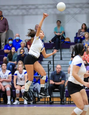St. John's Sophia Ochoa hits a ball in the first set as the Saints defeat Redeemer Christian on Tuesday.