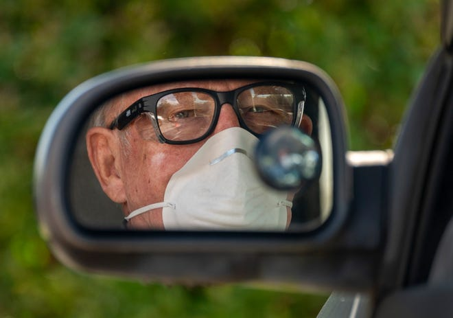 Alex Andruss, 80, waits to be tested for COVID-19 at a drive-thru testing station at FoundCare, Palm Beach County's first and only drive-thru coronavirus testing station in Palm Springs, Florida on March 19, 2020. [GREG LOVETT/palmbeachpost.com]