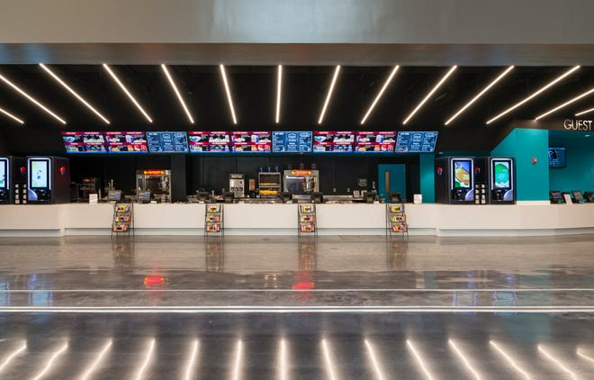 The concession stand at the CMX movie theater at the Mall at Wellington Green once again will greet customers when the theater reopens Friday.
