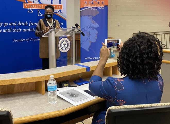 Del. Lashrecse D. Aird, D-Petersburg, takes a photo of state Sen. Mamie E. Locke, D-Hampton, during a news conference to announce the establishment of the John Mercer Langston Institute at Virginia State University in Ettrick, Va. Wednesday, Oct. 14, 2020.