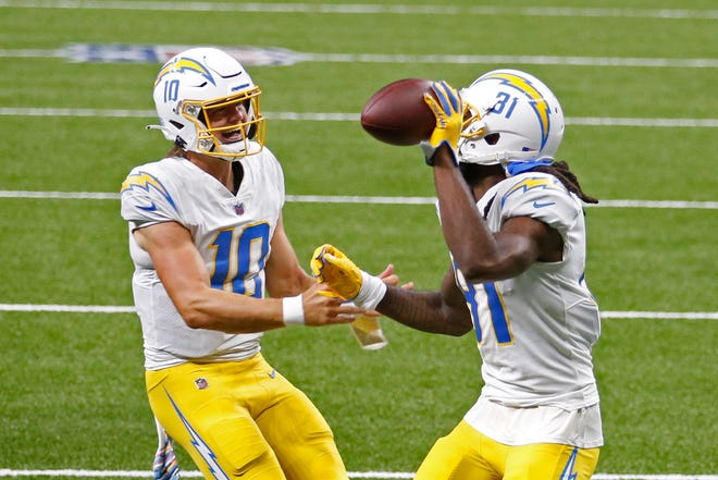 Los Angeles Chargers quarterback Justin Herbert (10) and wide receiver Mike Williams celebrate after Herbert threw a first-half touchdown pass to Williams in Monday's 30-27 overtime loss to the New Orleans Saints.