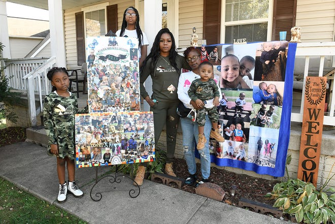 Ace Lucas' family from left, sister A'Launa Lucas (8) aunt Brayla Torrence (12) mother, Bria Nicole Torrence, grandmother, Timeka Torrence, and twin brother ArCel Lucas (1) pose with memories they have of Ace Lucas.