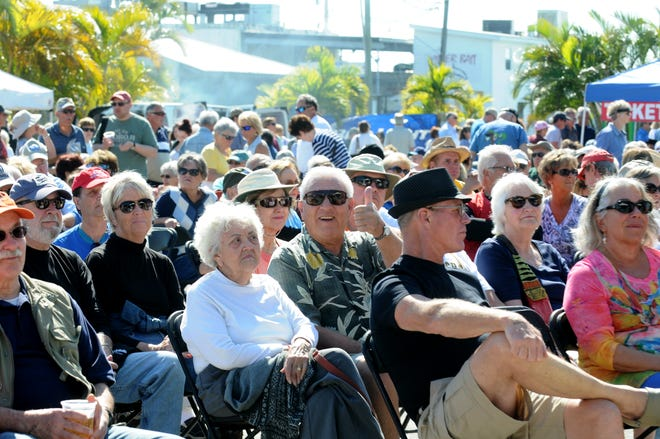 Crowds of people listen to bluegrass music at the 2016 Annual Cortez Commercial Fishing Festival in this Feb. 13, 2016, file photo. The 2021 version of the festival has been canceled because of the COVID-19 pandemic.