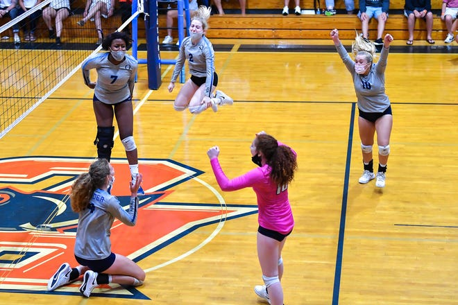 Out-of-Door Academy celebrates a point against Bradenton Christian in the Class 3A-District 7 semifinals Tuesday in Bradenton