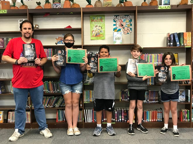 Pictured from left to right are Charles Curry with the four students who were honored for their comic books including Logan Nichols, Greyson Sharma, Ben Johnson and Lachlyn Lynam.