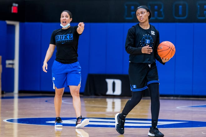 """The Duke women's basketball team had its first official day of practice on Wednesday at the K Center. Clinton native Mikayla Boykin (12) figures to be an """"important"""" player  for Kara Lawson, left, and the Blue Devils this season."""
