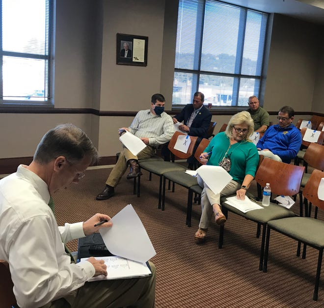 Election officials and other met Wednesday to approve poll workers for the 2020 vote. Etowah County Probate Judge Scott Hassell, Circuit Clerk Cassandra Johnson and Sheriff Jonathon Horton, as election officials, had to approve the list. Pictured from left: Hassell, Etowah County Republican Party Chairman Michael Barton, Horton, Johnson, ECSO Chief Deputy Mitchell Hill, and ECSO Chief of Administration Mike Powell.