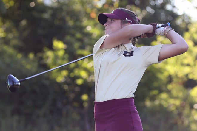 New Albany's Anna Coccia shot a 74 to help the Eagles capture their third consecutive Division I district title Oct. 13 at New Albany Links. The girls golf team will go for its third state title in a row Friday, Oct. 23, and Saturday, Oct. 24, at Ohio State's Gray Course.