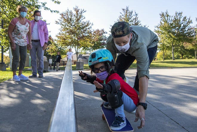 Stephanie and Merritt Chamberlain watch their grandson Sora Chamberlain, 5, skateboard with his father, Tristan Chamberlain, at Adventure Park in Powell on Oct. 7. Sora was born in 2015 with Prader-Willi syndrome, a rare genetic disorder