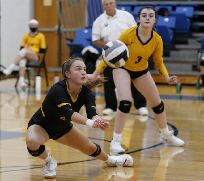 Upper Arlington's Macy Medors returns a shot against Hilliard Davidson in front of teammates Hannah Sprouse on Sept. 24. Medors, a junior libero, missed most of her sophomore year with a back injury.