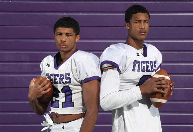 Brothers and Central standouts Lorenzo Styles Jr., left, and Alex Styles have helped the defending Division I state champion Tigers enjoy another outstanding season. Their father, Lorenzo Styles Sr., played at Ohio State and has been a defensive assistant coach for Central since 2012.